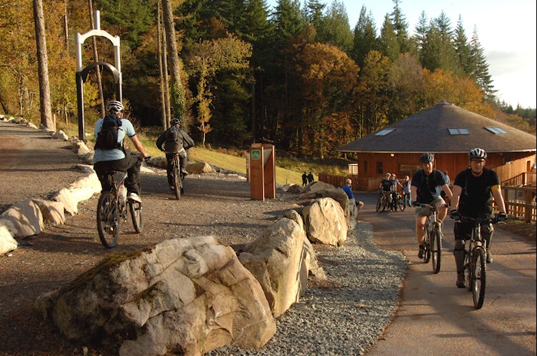 People cycling at a visitor centre