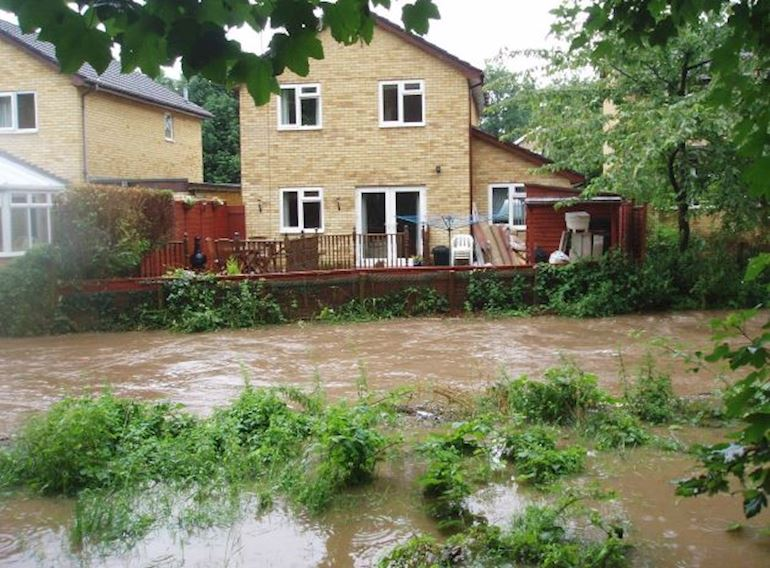 River burst its bank behind properties in Dinas Powys, 2007