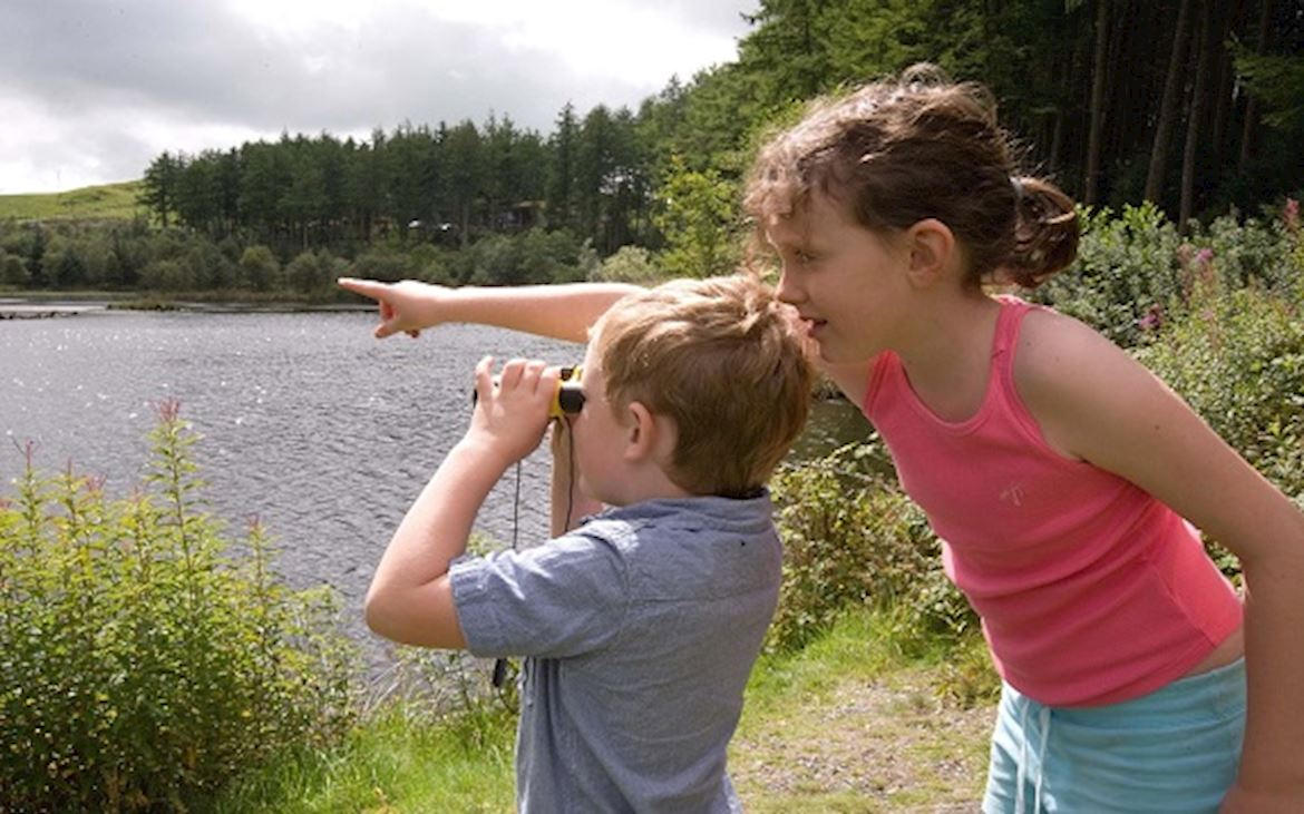Two children with binoculars